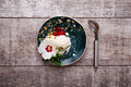 Top view of a vanilla ice cream on a plate and a scoop. Ice cream with a flower. Sweet dessert on a wooden background. Copy space. Royalty Free Stock Photo