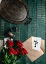 top view of vintage tray, red roses and envelope with valentine love card Royalty Free Stock Photo