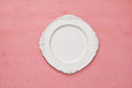Top view of vintage white empty plate. Flat lay Royalty Free Stock Photo
