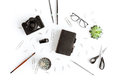Top view of wallet, camera and various office supplies and plant Royalty Free Stock Photo