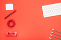 Top view of white keyboard and organized office supplies Royalty Free Stock Photo