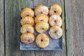 Top view on white sugar glazed mini donuts on a sheet metal tray