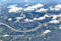 Top View from window airplane, crops field, road, street, river Royalty Free Stock Photo