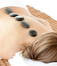 Top view of a woman with hot stones on her back Royalty Free Stock Photo