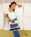 Top view of a woman on sofa using a laptop Royalty Free Stock Photos