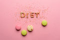 Top view of word diet made from candies isolated on pink