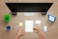 Top view of work desk with computer, pad, note, blank business card, mouse, plant, mug and desk frame Royalty Free Stock Photo