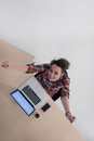 Top view of young business woman working on laptop computer in modern bright startup office interior Royalty Free Stock Photos