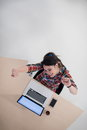 Top view of young business woman working on laptop computer in modern bright startup office interior Stock Photos