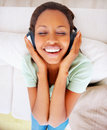 Top view of a young female listening to music Stock Image