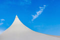 Top of white canvas tent against blue sky background. Royalty Free Stock Photo