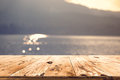 Top of wood table with blurred sea and sun light background Royalty Free Stock Photo