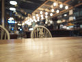 Top of wooden table with Blurred Bar restaurant background Royalty Free Stock Photo