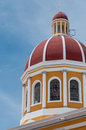 Top of yellow cathedral under blue sky in granada nicaragua central america Royalty Free Stock Photos