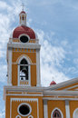 Top of yellow cathedral under blue sky in granada nicaragua central america Stock Photo