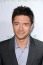 Topher grace at the take me home tonight los angeles premiere regal los angeles ca Royalty Free Stock Photos