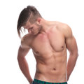 Topless fashion man with hands in bac pockets young holding his his back while looking down isolated on white background Stock Photo