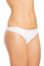 Topless woman in panties showin her flat belly showing isolated on white Royalty Free Stock Images