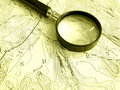 Topographic map with magnifier Royalty Free Stock Photos