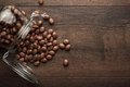 Topple over glass jar full of chocolate sweets background Stock Images