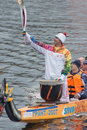 Torchbearer on a boat with dragon head tver october october tver russia in tver in the olympic torch relay was attended by Stock Photos