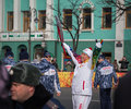 Torchbearer carries the olympic flame vladivostok russia november in relay of on november in vladivostok russia Stock Photography