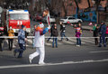 Torchbearer carries the olympic flame vladivostok russia november in relay of on november in vladivostok russia Royalty Free Stock Photos