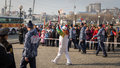Torchbearer carries the olympic flame vladivostok russia november in relay of on november in vladivostok russia Stock Image