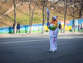 Torchbearer carries the olympic flame vladivostok russia november in relay of on november in vladivostok russia Stock Images