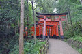 Torii gates in kyoto japan a is a traditional japanese gate most commonly found at the entrance of or within a shinto shrine where Royalty Free Stock Photo