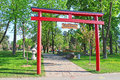 Torii in a stylized Japanese garden Royalty Free Stock Photo
