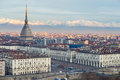 Torino Turin, Italy: cityscape at sunrise with details of the Mole Antonelliana towering over the city. Scenic colorful light on Royalty Free Stock Photo