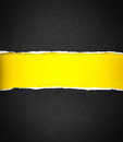 Torn black Paper and space for text with yellow paper background Royalty Free Stock Photo