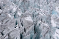 Torn glacier with many crevasses in detail