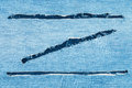 Torn jeans fabric in the shape of Z Royalty Free Stock Photo