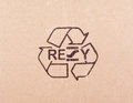 Torn out piece of cardboard with recycle symbol Royalty Free Stock Photo