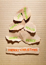 Torn paper christmas tree with wishes Stock Images