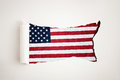 Torn paper reveals the American flag Stock Image