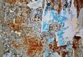 Torn posters colorful on grunge old walls as creative and abstract background Royalty Free Stock Image