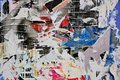 Torn posters colorful on grunge old walls as creative and abstract background Stock Photo