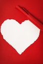 Torn red paper in the form of heart Royalty Free Stock Photography