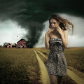 Tornado destroying a woman s house insurance concept Stock Images