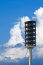 Tornado warning siren against cloudy sky and approaching storm Stock Images