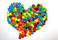 TORONTO, CANADA - March 10, 2017: A heart-shaped pile of colorful coated chocolates M&M Royalty Free Stock Photo