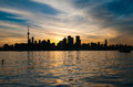 Toronto city skyline at sunset view of silhouette over ontario lake Stock Photo