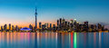 Toronto panorama at dusk viewed from island park Royalty Free Stock Photo