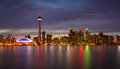 Toronto skyline at night and reflection colorful lights from reflected on lake ontario twilight Stock Photos
