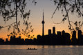 Toronto Sunset Silhouette with  canoeists in the water Royalty Free Stock Photo
