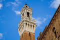 Torre del mangia siena detail close up on the the bell tower of the city hall palace comune in italy Stock Image