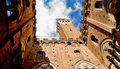 Torre del mangia from the yard view of tower of city hall in siena inside palace cortile podestà Stock Photography